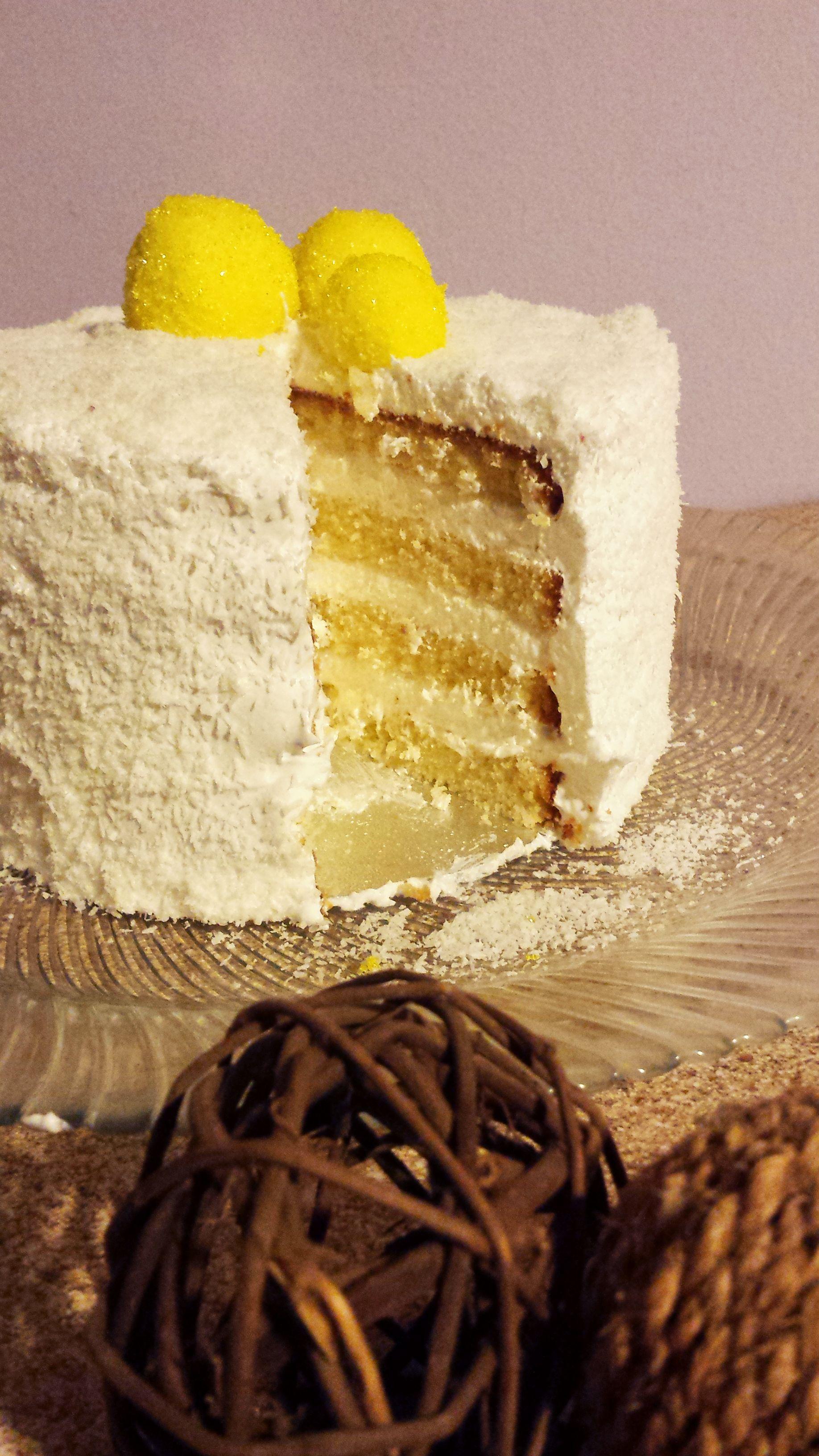Vanilla cake with vanilla cream and coconut flakes