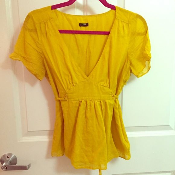 J. Crew mustard yellow blouse Perfect color for fall! Mustard yellow top with side zip and a tie back. Great used condition. Size tag is cut off, but I think it's a small. J. Crew Tops Blouses