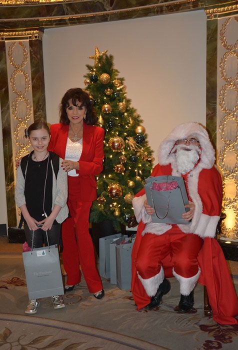 Joan Collins hosts a special tea party for the Shooting Star Chase children's hospice - Photo 4