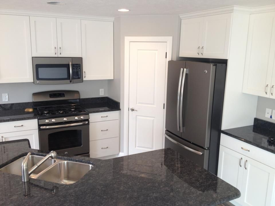 white kitchen appliances with dark cabinets ge slate appliances and no fingerprints 28609