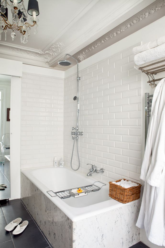 subway tiling in vintage french apartment bathroom