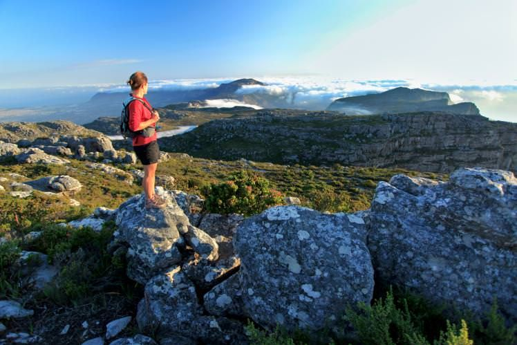 Hiker atop Table Mountain, Cape Town, South Africa. Image by Jacques Marais / Getty