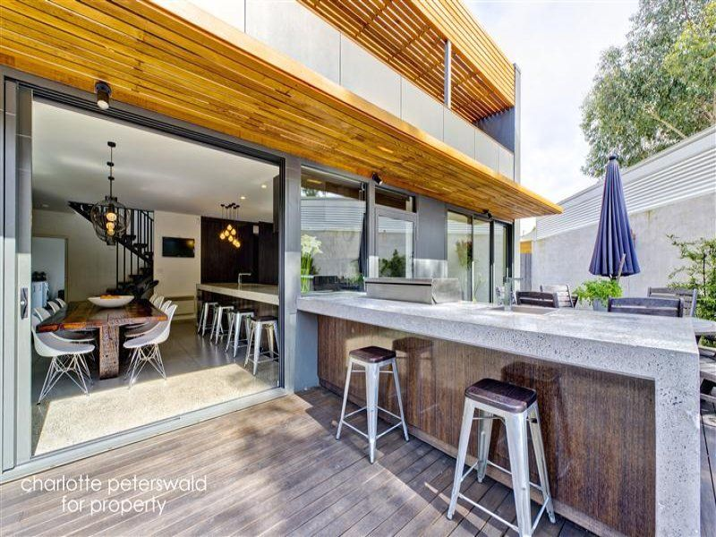 Gorgeous Inside To Outside Waterfall Concrete Kitchen