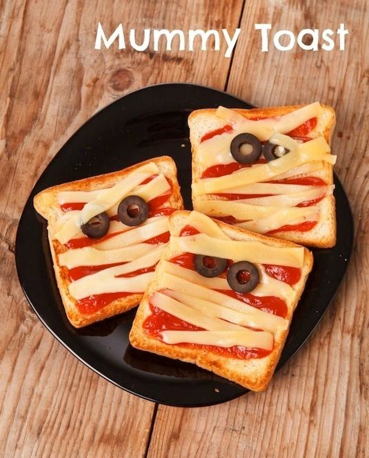 Mummy Toast - Bread, strips of cheese, and sauce, olives for eyes - add pepperoni's