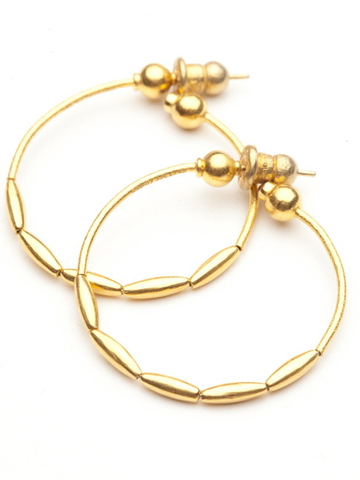 Every lady needs a basic hoop earring. This one made by Gurhan is perfect for almost anyone. It is light and rich in color, since it is made of 24kt yellow gold. At the end of the hoops are hidden bezel set rubies. It is 1.5 inches from top to bottom.