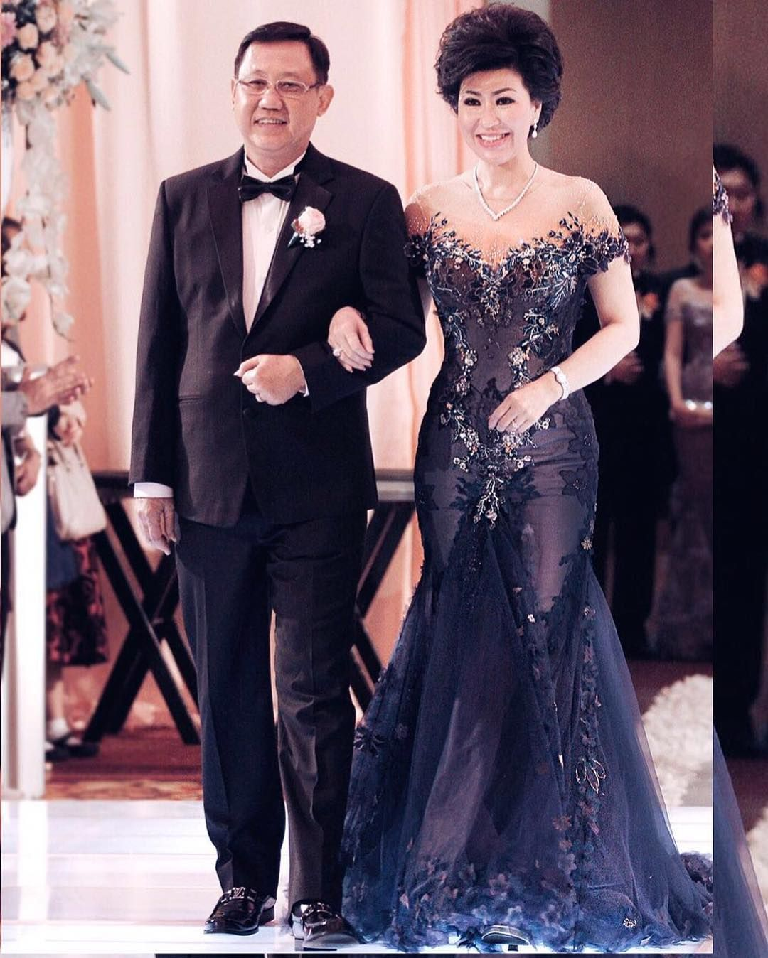 Dark blue wedding dress  This dark navy blue formal gown has an off the shoulder looking