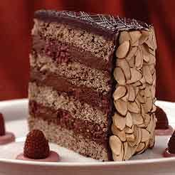 Julia Child's Eighty-Fifth Birthday Cake - Rasberry almond with shaved chocolate. This is the BEST cake. I've made it dozens of times. It was even the recipe I used for my brother's wedding cake.