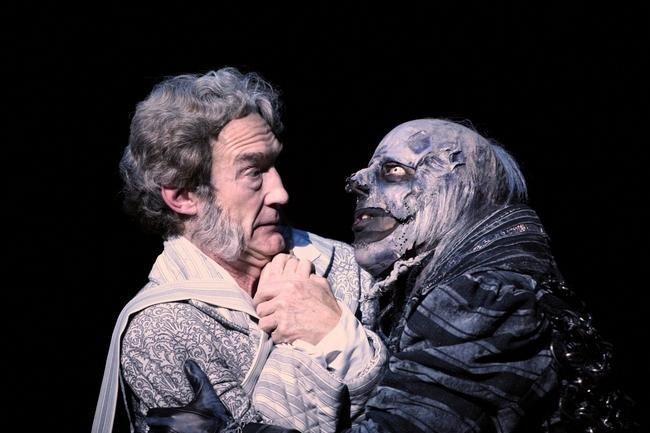 Guy Paul, left, portrays the despicable-then-loveable Ebenezer Scrooge in Geva Theatre ...