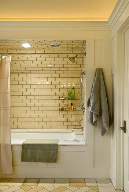 Subway Tile Up Onto The Ceiling Of The Shower Over Tub