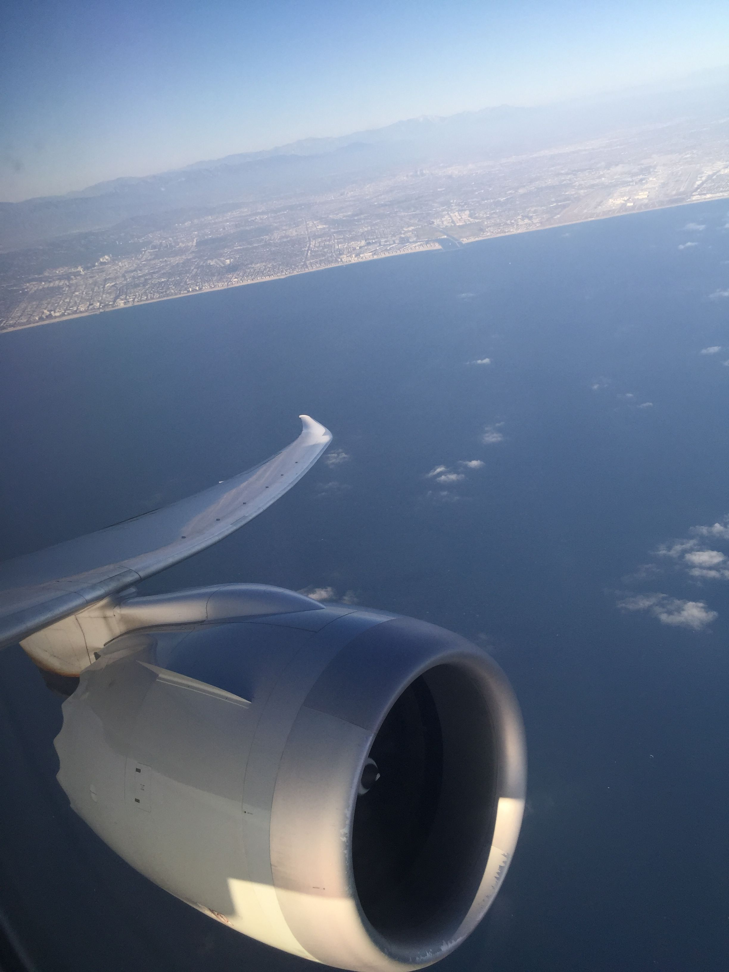 Window view from seat 4A American Airlines 787-800 (backwards facing seat) takeoff from LAX
