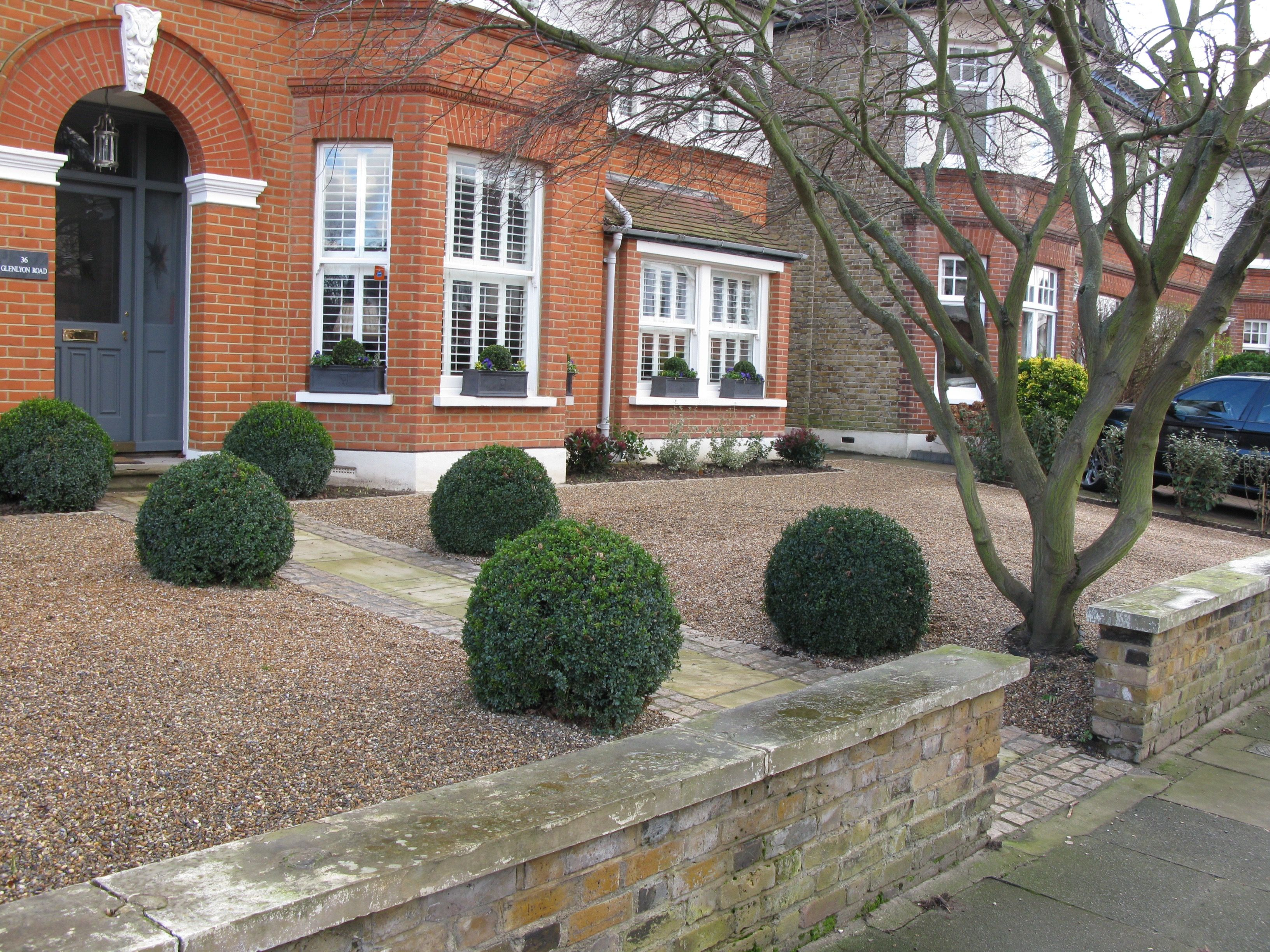 The London front garden of a triple-fronted house. At the ...