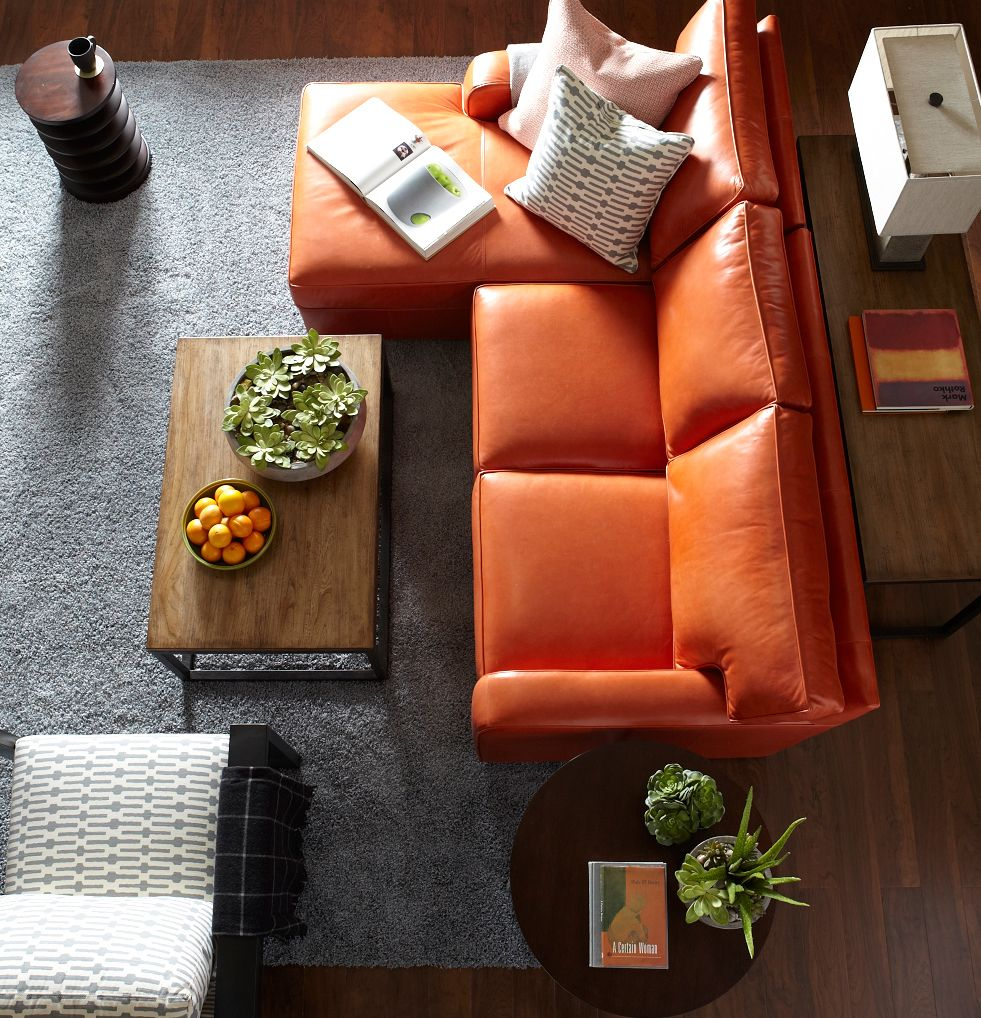 Orange Leather Couch In A Great Living Room Layout