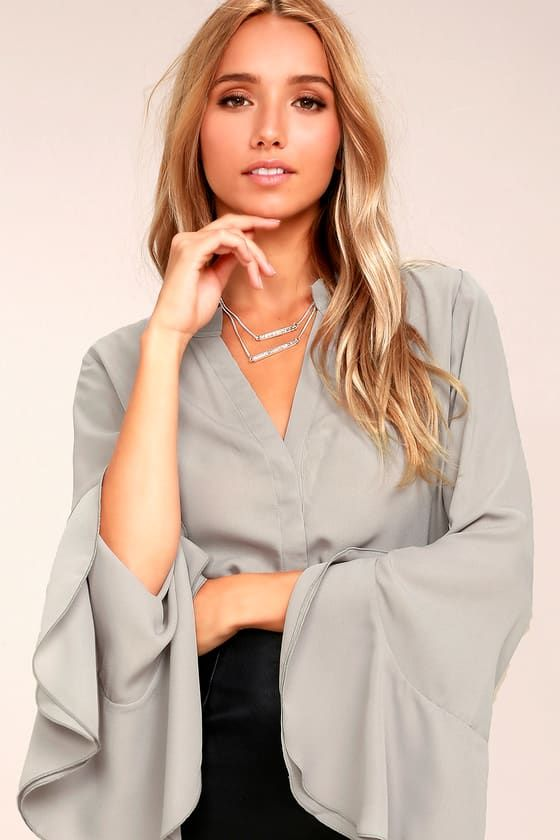 c34a04f43fd541 For an easy sophisticated look just slip on the Chic Charm Light Grey Long Sleeve  Top! Woven poly shapes a raw