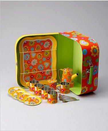 metal tea set in suitcase
