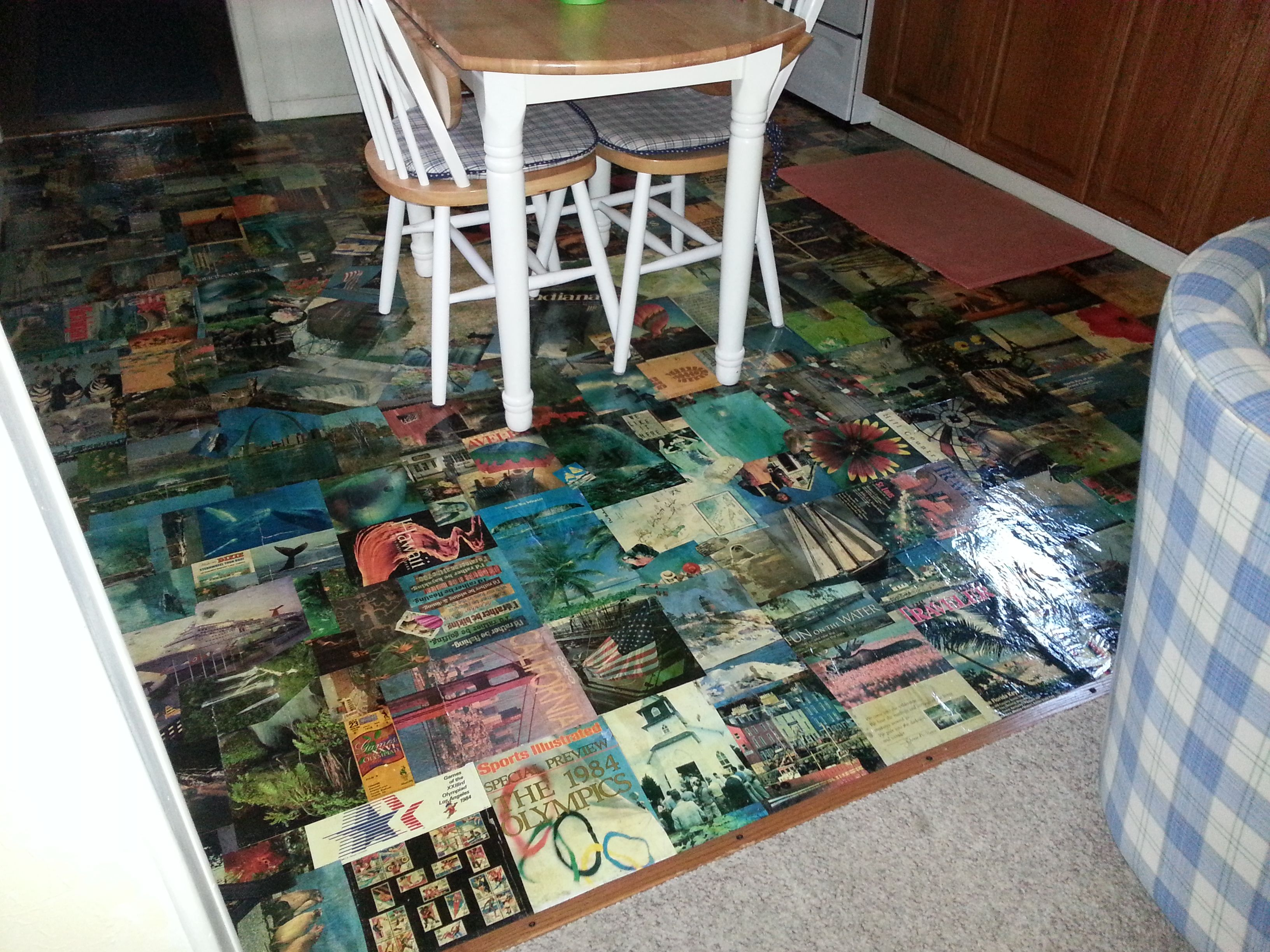 Awesome floor made from magazine pages.  Pages placed on floor using wallpaper paste then 2 coats polyurethane.  This one has a theme of places they have traveled.