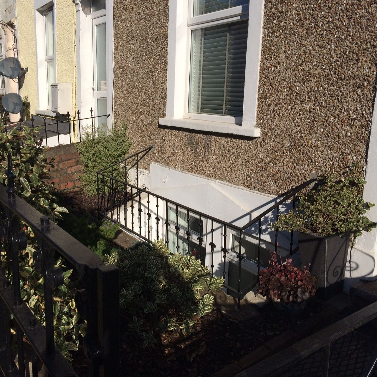 Victorian Flat Fronted House With Basement Conversion Showing Exterior  Window With Railings