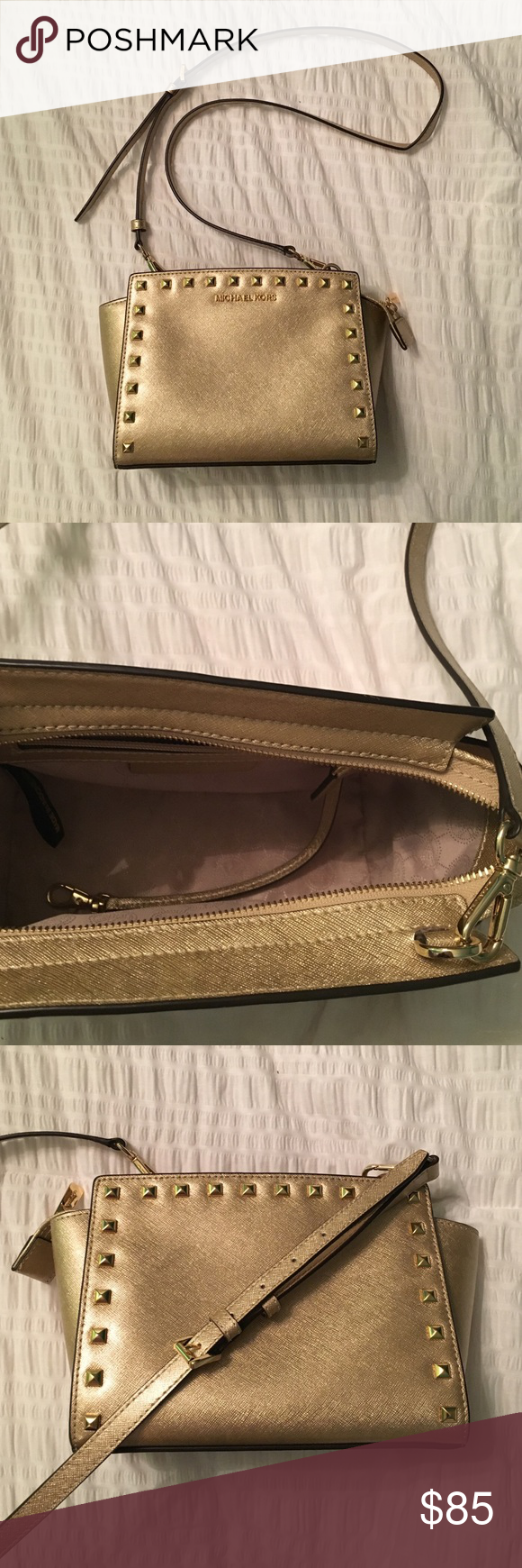 23d66b2e9f50 Michael Kors Selma Mini gold studded Michael Kors Selma mini with studs.  Gold saffiano leather. Never been worn and in perfect condition!