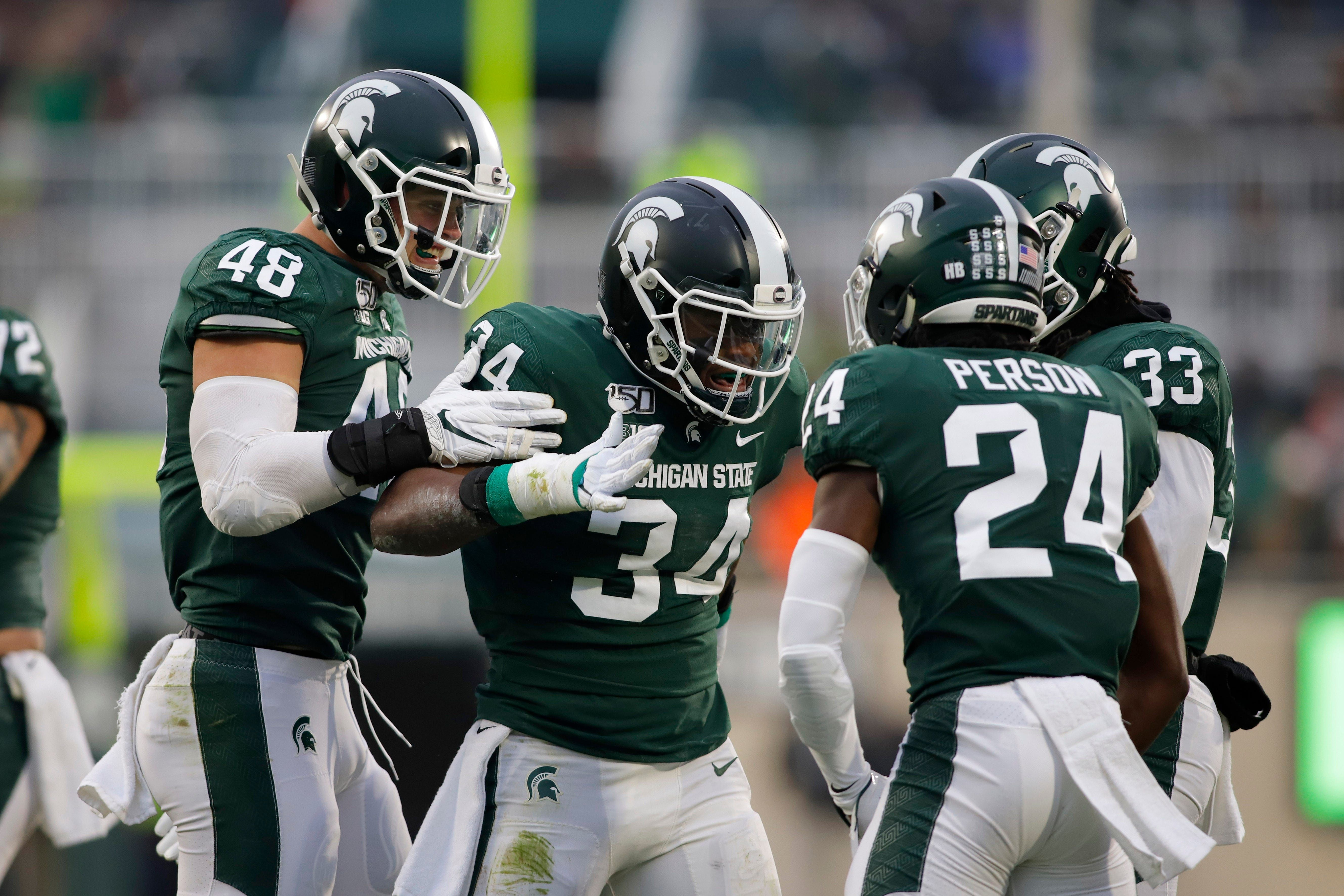 Michigan State S Offense Struggles But Finds Way To Beat Maryland Becomes Bowl Eligible Michigan State Football Michigan State Michigan State Spartans Football