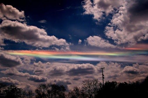 Why would clouds appear to be different colors? The reason here is that ice crystals in distant cirrus clouds are acting like little floating prisms.