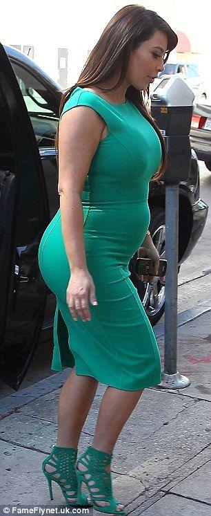Alone again: Pregnant Kim Kardashian cuts a sombre figure as she ...
