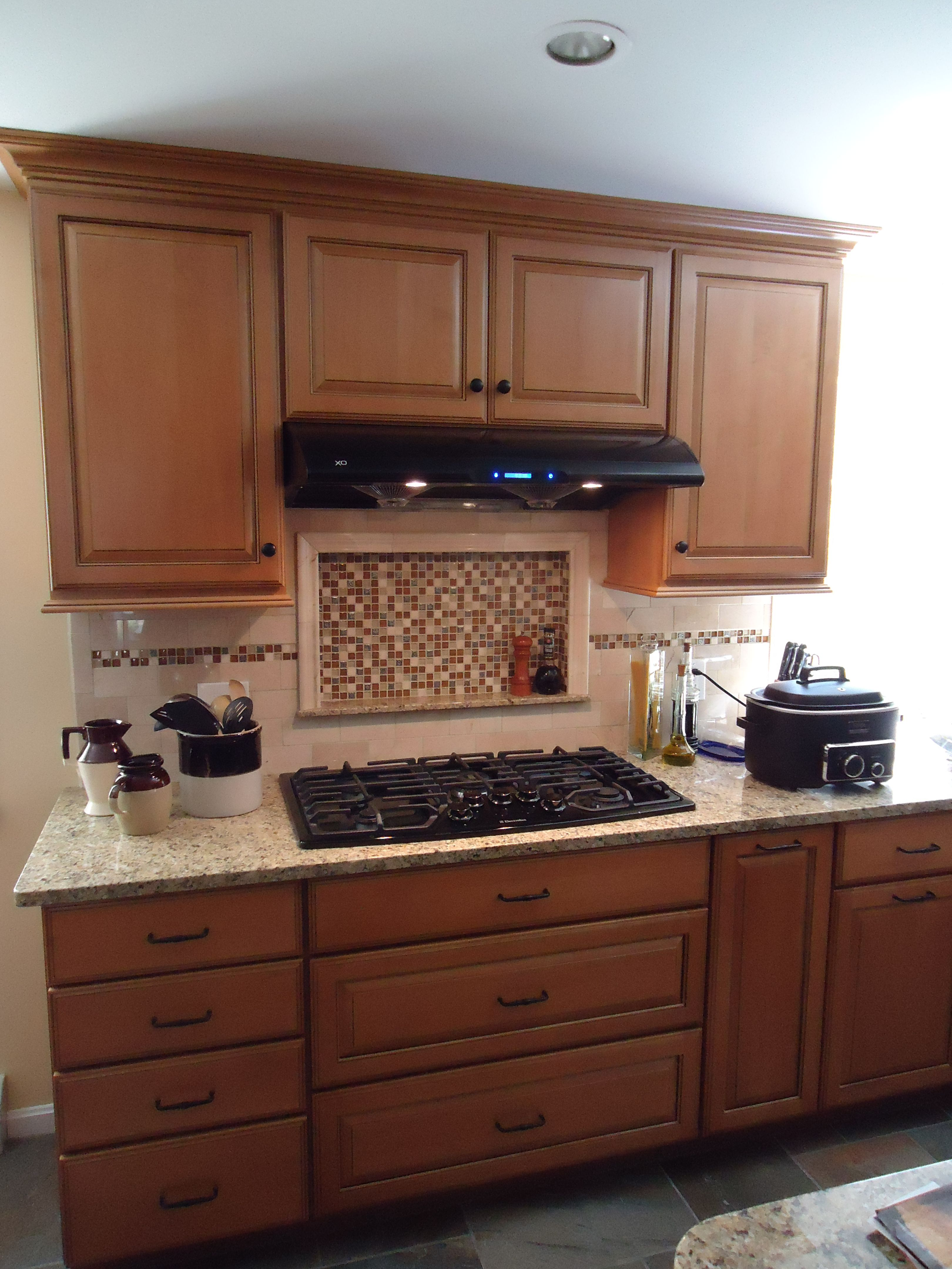 Raised Panel Maple Cabinets with medium stain and New Venetian Gold Granite Counters.  Nester's Kitchen & Bath, Conway, NH