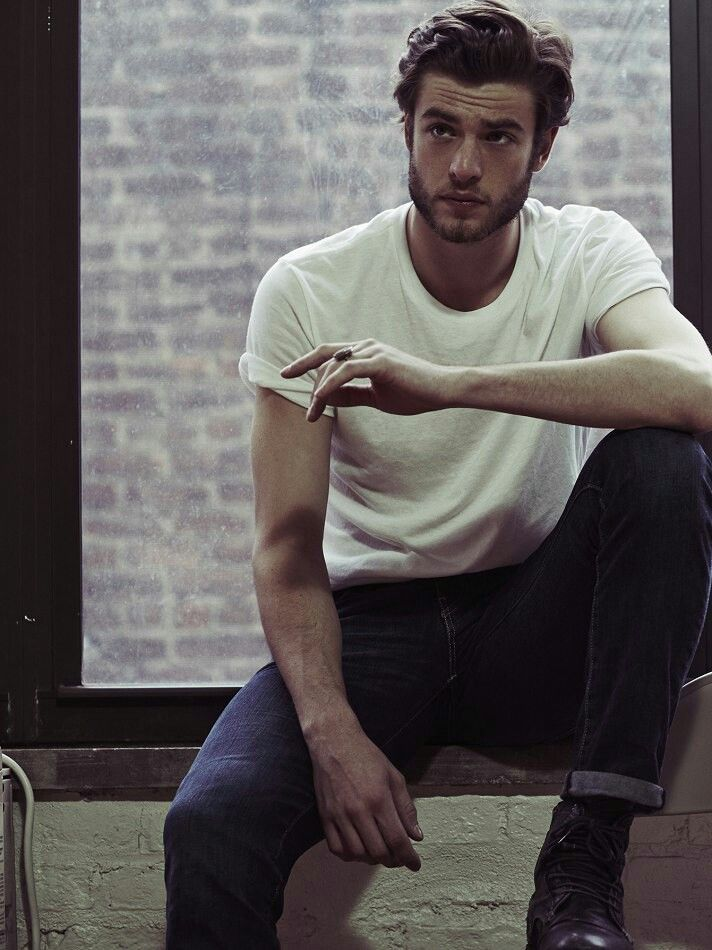 Gaspard Menier- bad boy looking sexy wearing a classic white T-shirt and original cuffed blue jeans.