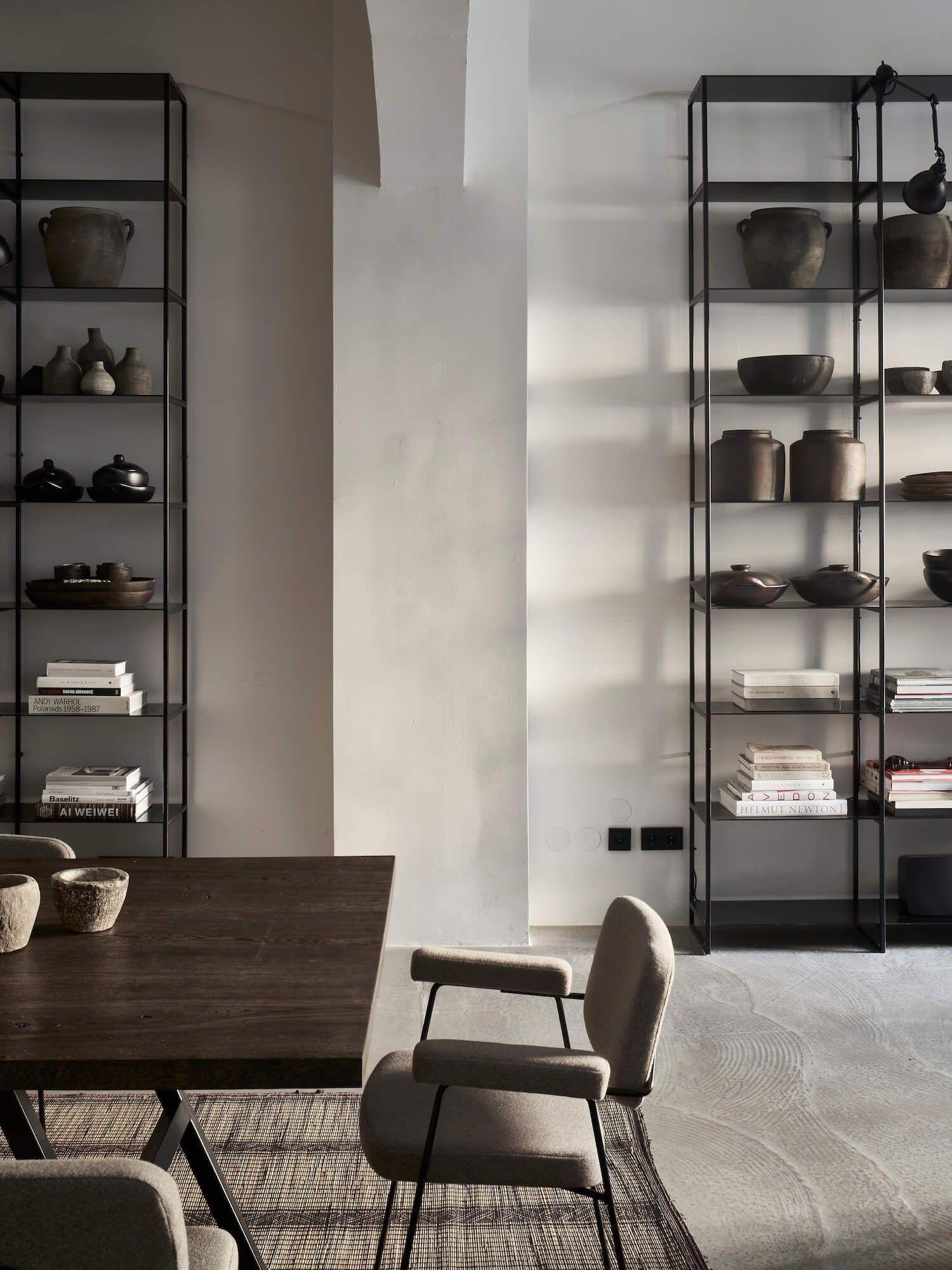 Tall metal shelves, concrete slab floor, modern furniture