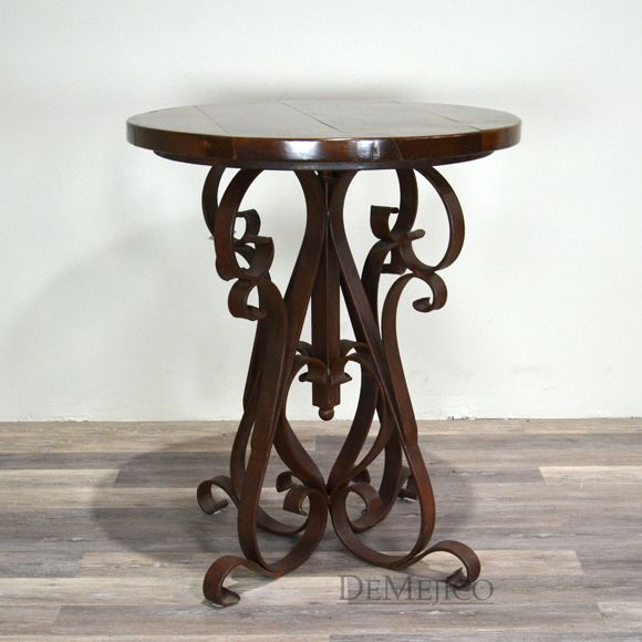 This tall Spanish bar table shows off a smooth mesquite top, help up by a hand forged scrolled base.