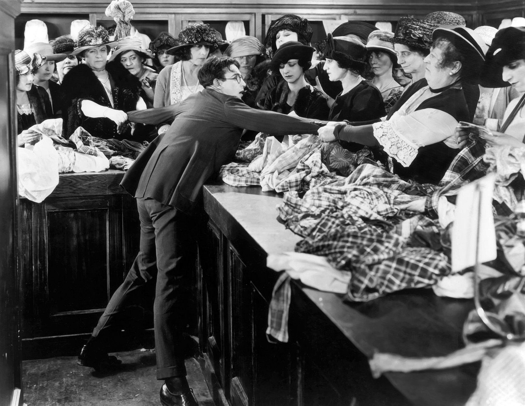 Harold Lloyd is caught in a department store bargain