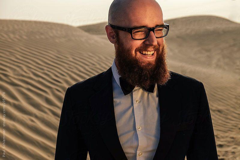 Smiling bearded man in the desert by Paul Schlemmer #stocksy #realstock