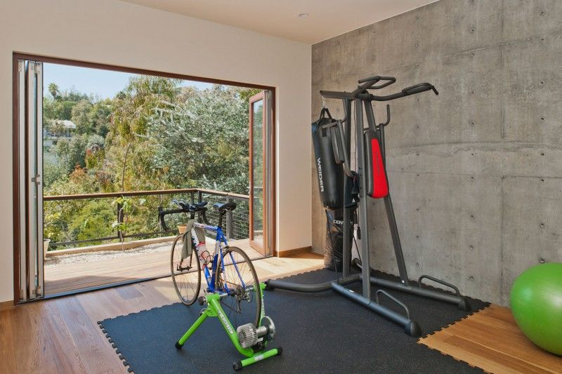 Broom Way House Designed in Contemporary Flair around Forest : Interesting Sports Room With Supplies Sports Equipment On Mattras And Connect...