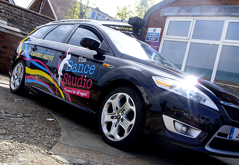 The Dance Studio Car Graphics Done By The Sussex Sign Company - Vinyl graphics for a carfull color car vinyl graphic checkered flag wrap