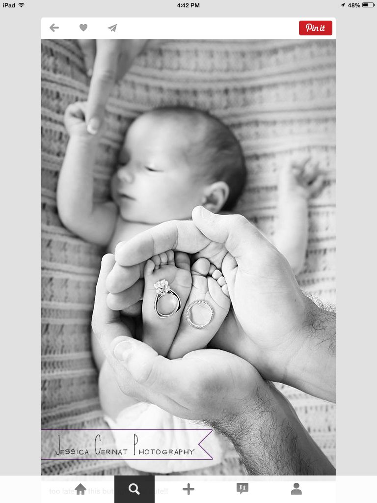 Baby with parents wedding rings
