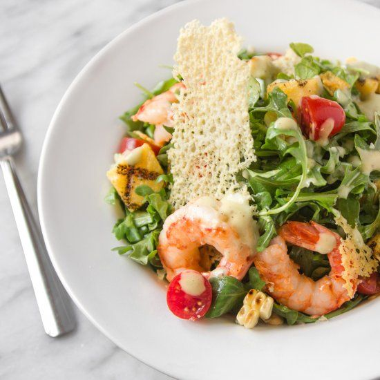 Grilled shrimp, sweet corn and arugula salad with polenta croutons, Parmesan crisps and creamy garlic dressing from Nordstrom.