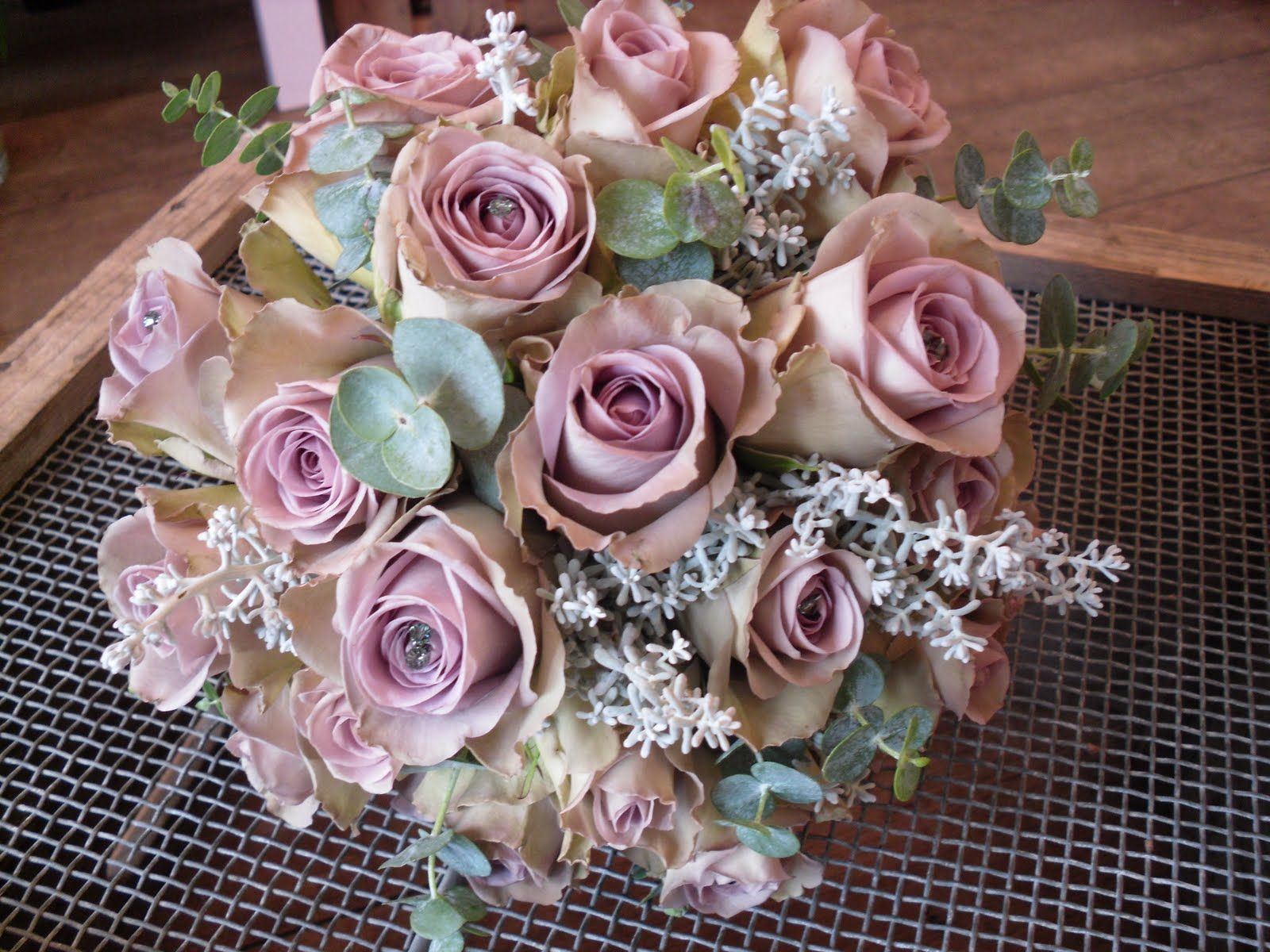 handtied bouquet of 'Amnesia' Roses with Eucalyptys & a