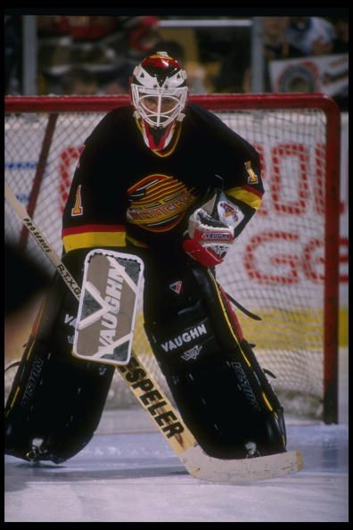Goaltender Kirk McLean of the Vancouver Canucks looks on during a game  against the Buffalo Sabres at Memorial Auditorium in Buffalo New York The. 50992d230