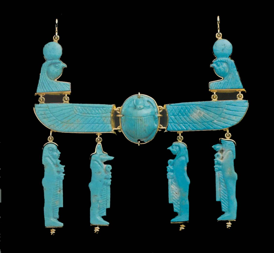 Faience amulet pectoral featuring a winged scarab and the four sons of Horus. 26th dynasty. 664-525 B.C. | The Barakat Gallery
