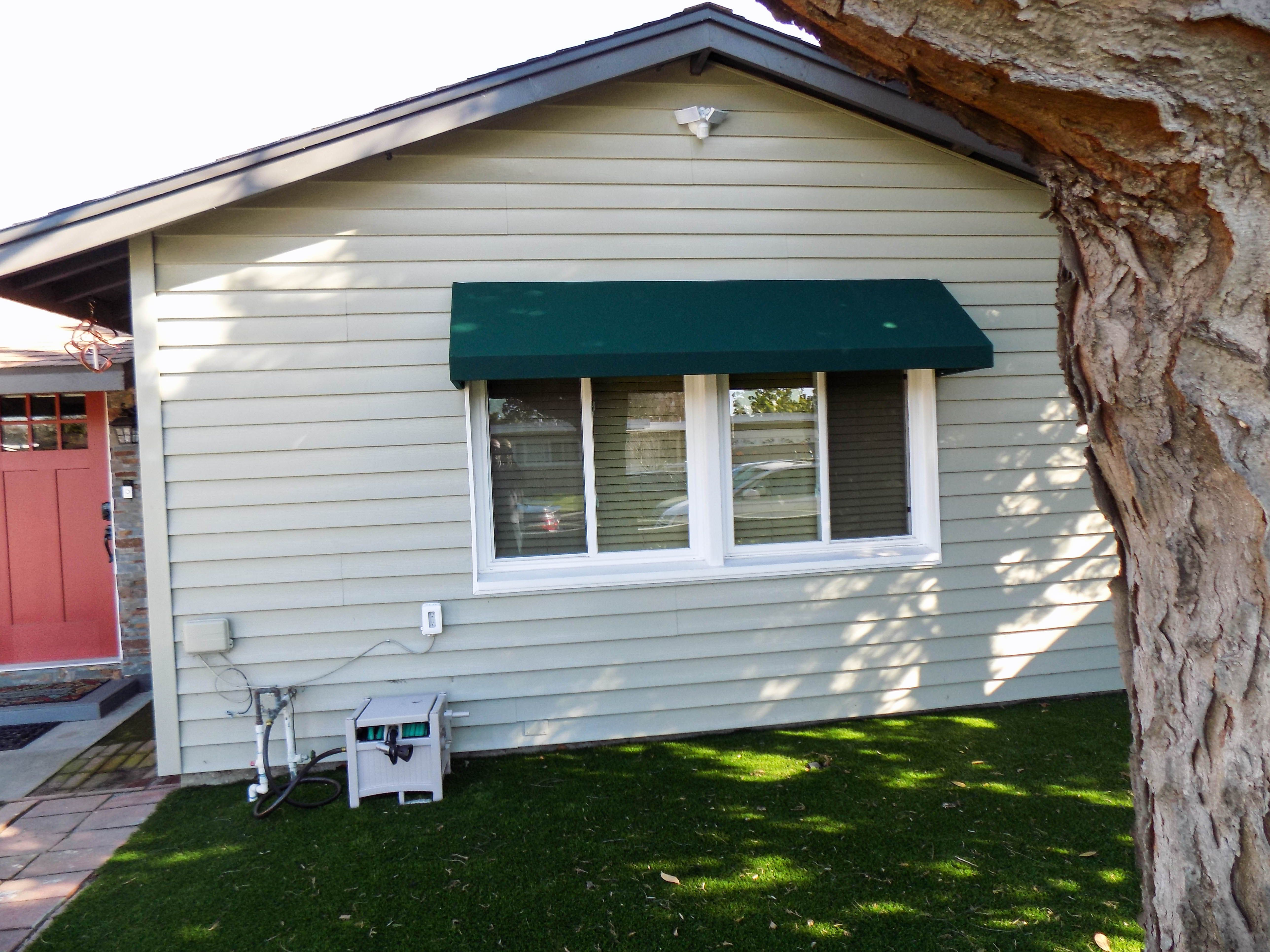 Add Shade To Your Windows While Also Adding Curb Appeal With A New Awning On This Particular Installation In Long Beach C Curb Appeal Homeowner Outdoor Decor