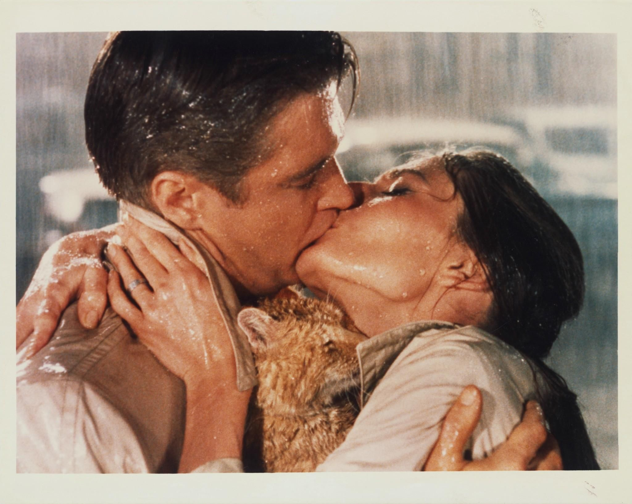 Paul and Holly (and Cat) - George Peppard and Audrey Hepburn - Breakfast at  Tiffany's | Movie kisses, George peppard, Breakfast at tiffany's movie