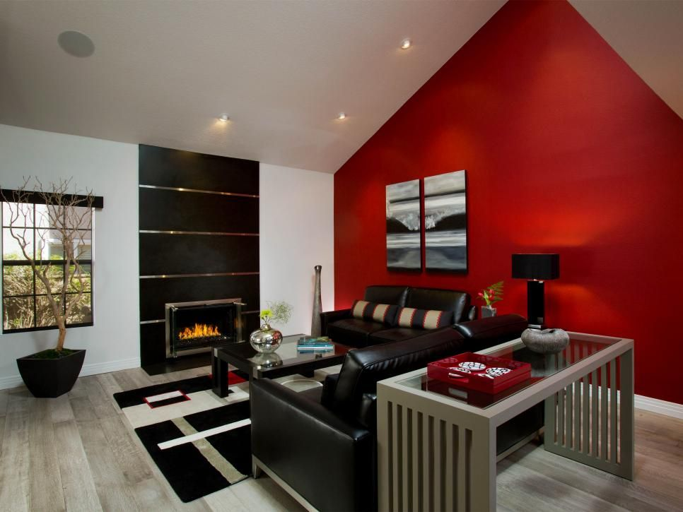 A Bright Red Accent Wall Draws You In As You Walk Into This Sleek Black And White Space The Fire Accent Walls In Living Room Living Room Red Living Room White