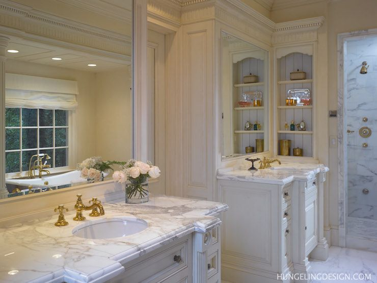 Traditional Bathroom With His And Her Vanity Sinks In Antique White Finish  Topped With White Marble