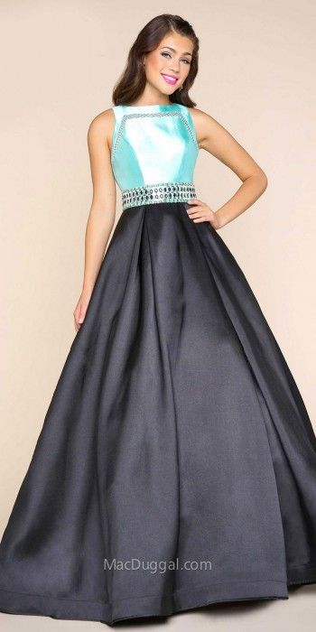 Arrive in the ultimate style to your next party in this Keyhole Back Color Blocked Embellished Evening Dress by Mac Duggal. This glamorous dress features a form fitting bodice with a jewel neckline that has a cut out net detailing for a unique appearance. This style also features a keyhole open back and contrasting rhinestone embellishments along the waistline. #edressme