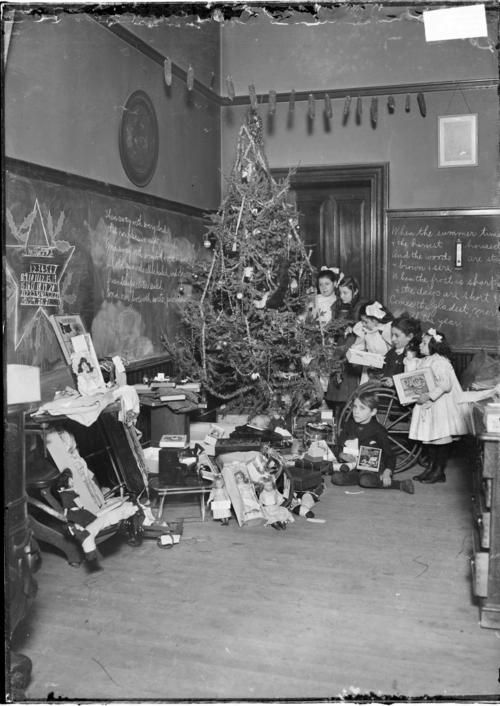 Chicago History In Pictures Students Enjoying The Gifts Left For Them Under Christmas Photograph Vintage Christmas Vintage Christmas Photos