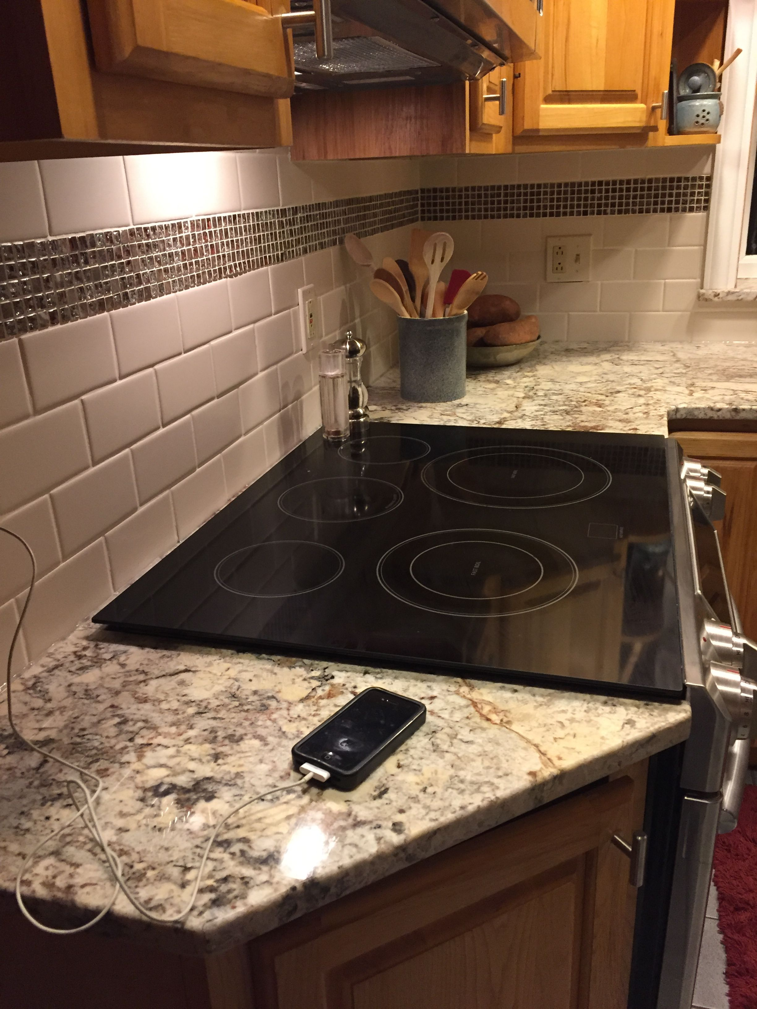 - Sienna Bordeaux Granite, Almond Subway Tile With Icy Red Mini