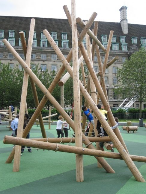 "Jubilee Gardens Playground, London.  From the UK Playground Adventure blog.  Just one part of a massive wood and net climbing structure - note that a sign at the playground says: ""for 11 years and under - no big kids!"".  Myself I find that disappointing - I think playgrounds should encourage mixed age play whenever possible, and this structure would be of interest to older children too."