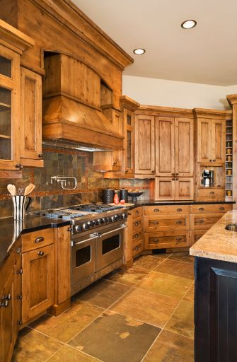 How To Decorate Around Natural Wood Kitchen Cabinets Hunker Natural Wood Kitchen Cabinets Rustic Kitchen Rustic Kitchen Cabinets