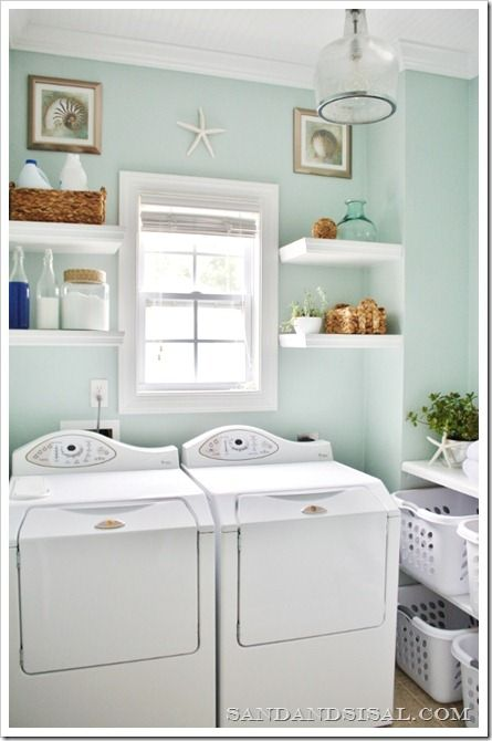 "Pretty Laundry Room - Sherwin Williams ""Rainwashed"" paint, white beadboard ceiling, Ballard Designs seeded glass ""Addie Pendant"" light, sorting station, pretty bottles for detergent, and fabric softener sheets in baskets"