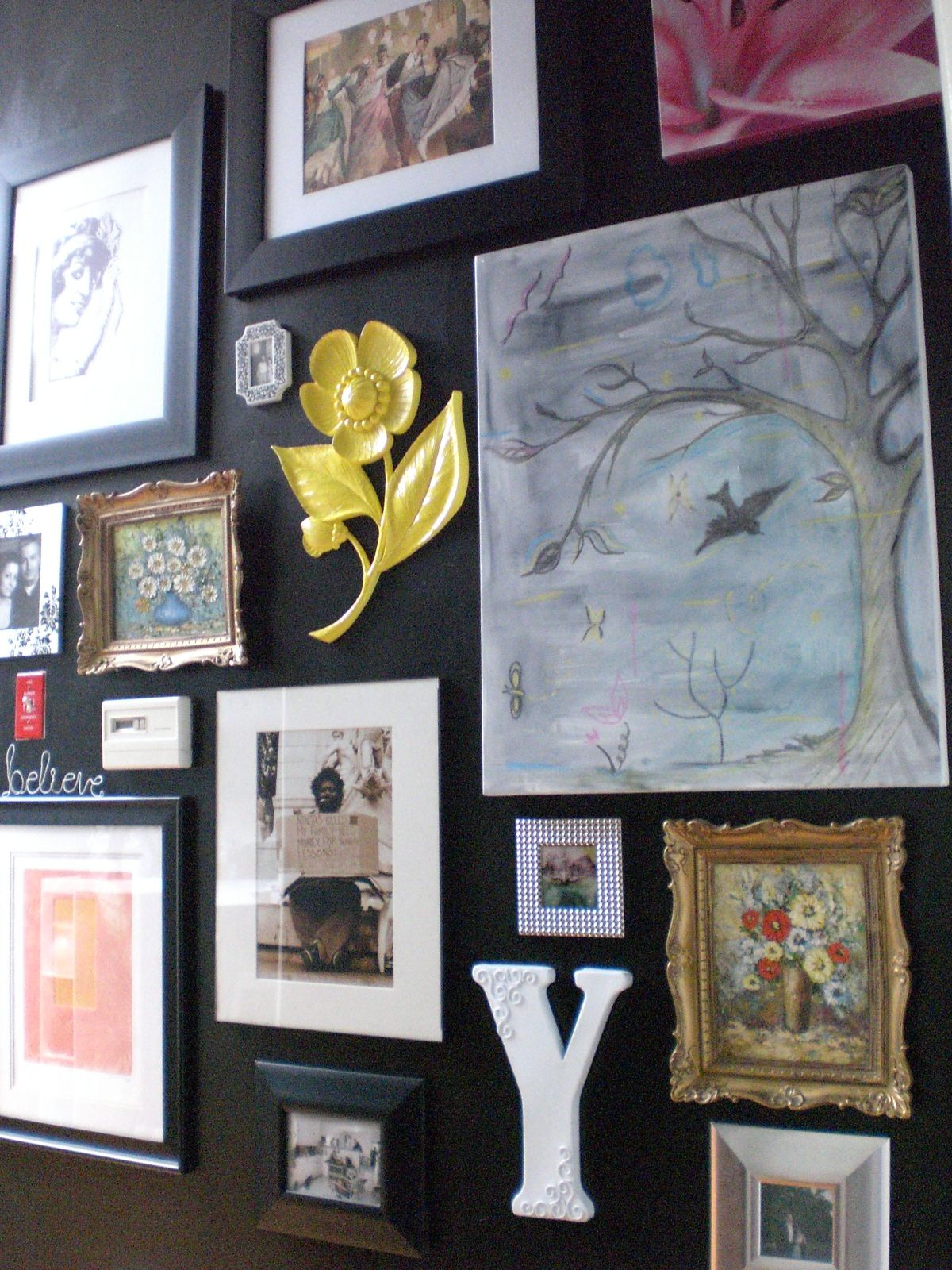 Lots Of Frames And Nick Nacks On A Dark Wall