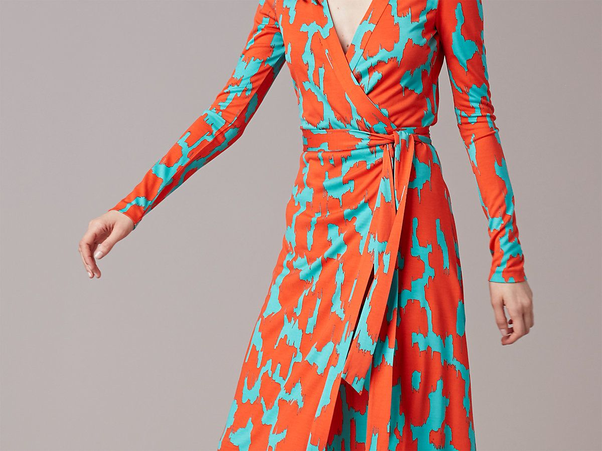 Cut in a plush silk jersey, this knee-length, long-sleeve wrap dress features a V-neck with a band along the neckline, and our vivid and invigorating custom Eylan print in red. <br> <br> Fit runs small, we suggest you take a size up.