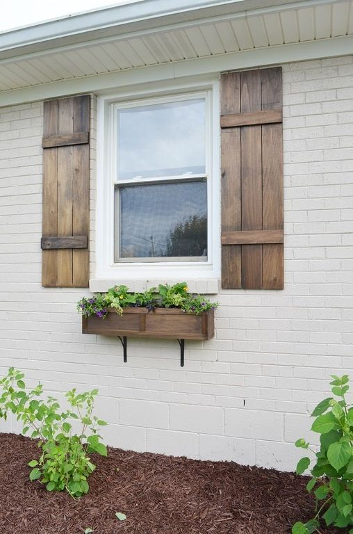 11 Quick And Easy Curb Appeal Ideas That Make A Huge Impact House Exterior Board And Batten Shutters Diy Shutters